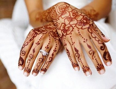 Bride's hands decorated with elaborate henna after Mehendi ceremony.