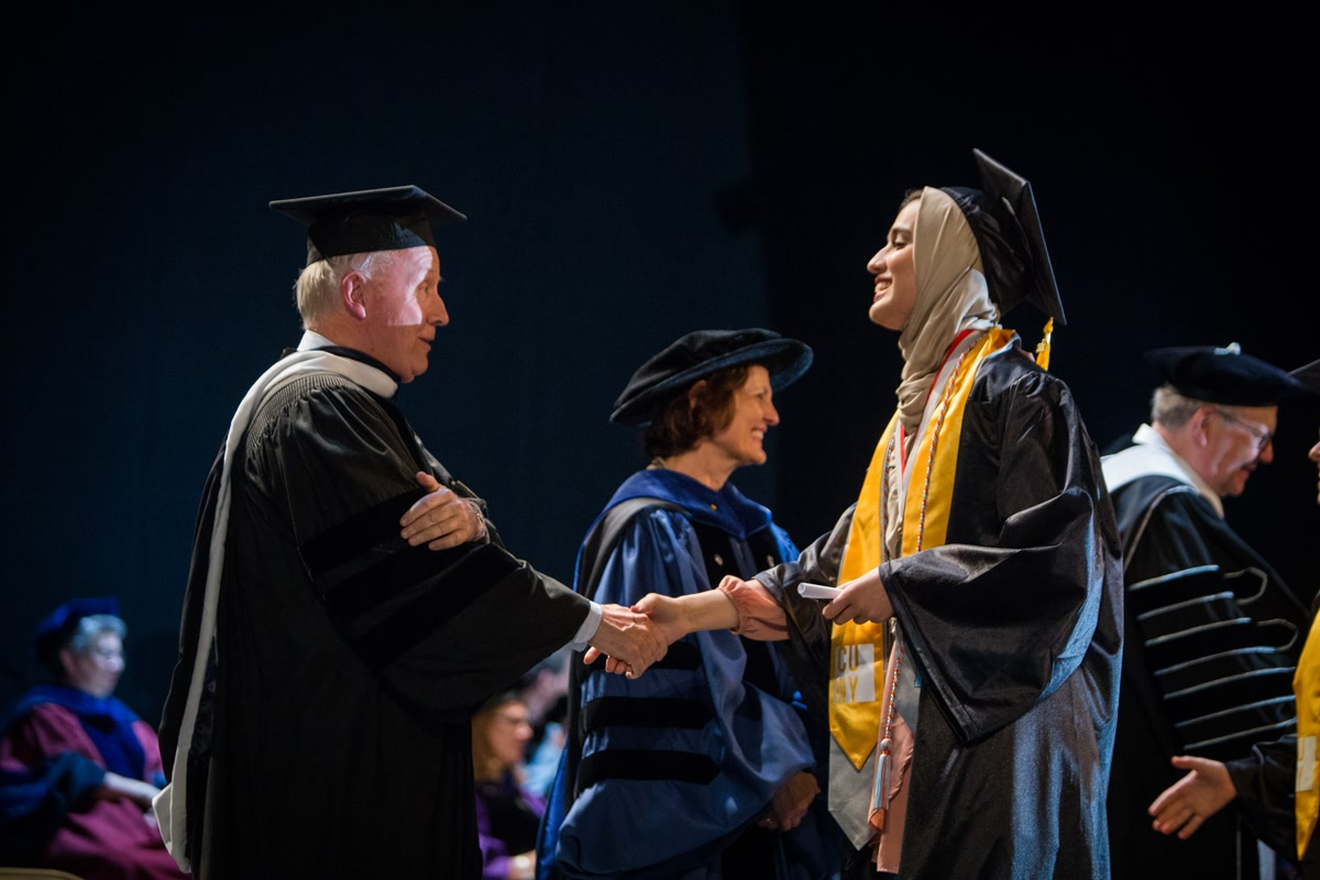 Student shaking hand at 2017 Macaulay commencement