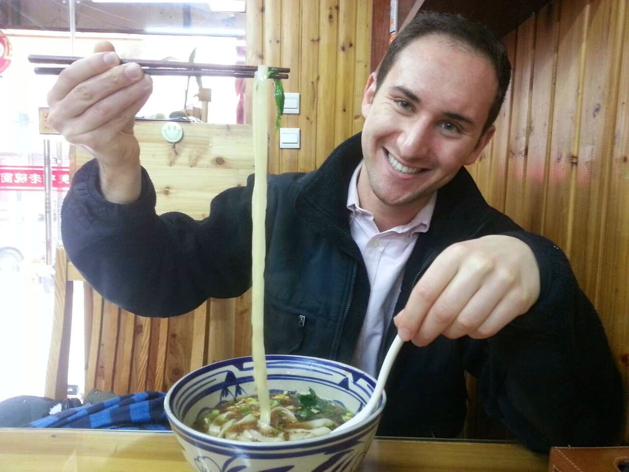 prospective students macaulay honors college macaulay student noodles in restaurant during study abroad trip to