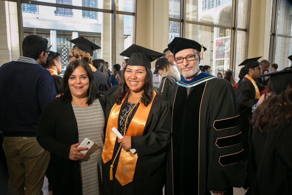 Student and her mom at commencment with Gary Schwartz. Photo by Arpi Pap.