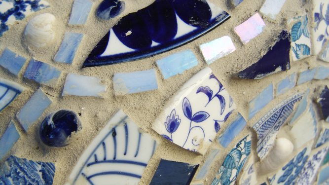 Photo of broken pottery pieces made into a pattern
