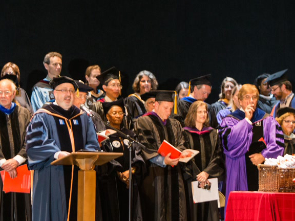 Professor Ugoretz addresses the class of 2017 during Macaulay Commencement