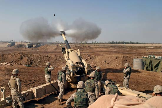 An M-198 155mm Howitzer of the US Marines firing at Fallujah, Iraq, during the Second Battle of Fallujah.