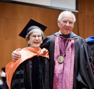 Honorary degree awardee Virginia Slaughter with CUNY Chancellor Matthew Goldstein at commencement for the Macaulay class of 2013.