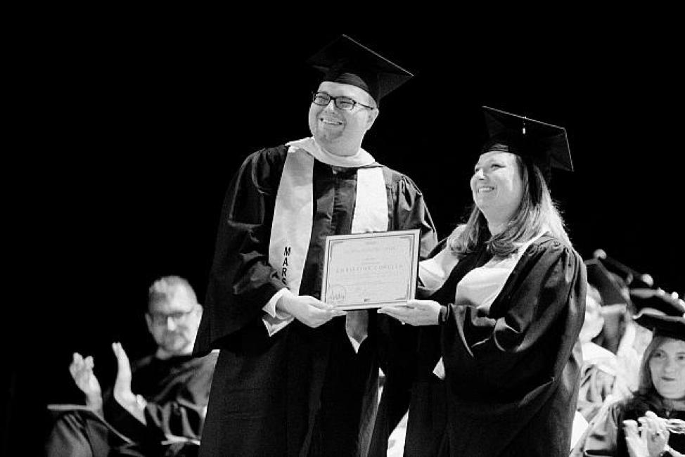 Christine Curella '08 receives her Macaulay Pioneer award in 2018.
