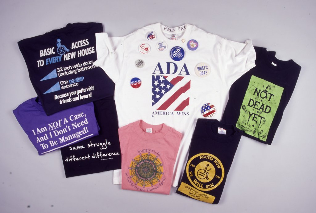 """These T-shirts express the energy and humor of the disability rights movement: """"Not Dead Yet,"""" """"same struggle, different difference,"""" """"Access Now,"""" """"I am not a case, and I don't need to be managed."""""""
